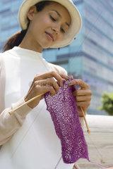 Woman knitting outdoors