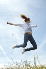 Woman jumping in midair