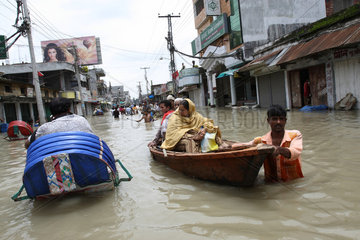People move through boat during flood