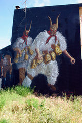 Italy. Sardinien  Maske von die Merdules Wandmalerei in Tinnuri