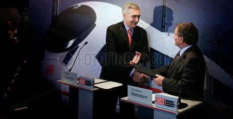 CEO of Siemens  Peter Loescher and CEO of Deutsche Bahn  Hartmut Mehdorn