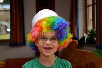 happy boy as a clown