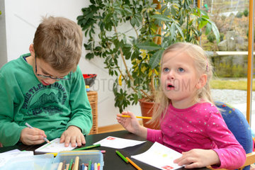 Two children when drawing