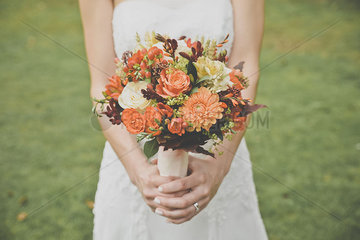 Bride holding bouquet  cropped