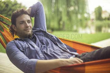 Man reclining in hammock