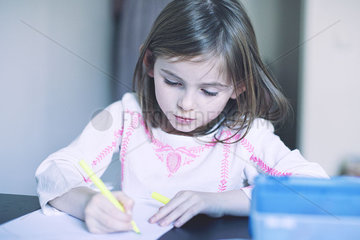 Girl drawing in notebook