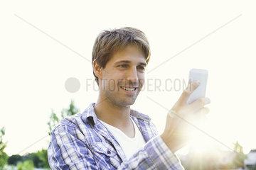 Man text messaging while enjoying outdoors