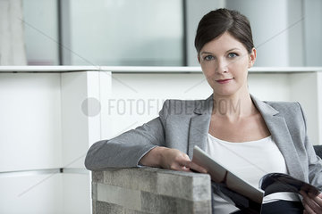 Woman in waiting room looking at magazine