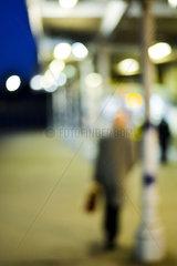 Pedestrian walking at night  defocused