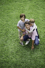 Father and sons together outdoors  portrait