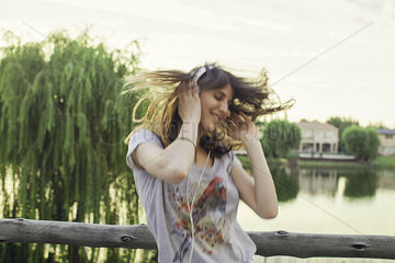 Young woman enthusiatically listening to music