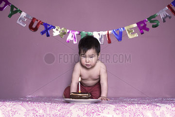 Baby blowing out birthday candle