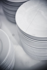 Plates stacked on table