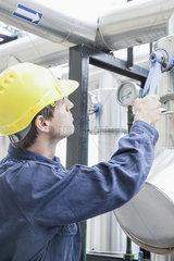 Engineer working on industrial equipment
