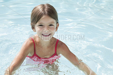 Girl swimming in pool  portrait