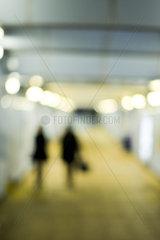 Pedestrians walking at night  defocused