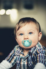 Baby boy with pacifier in his mouth  portrait
