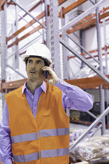 Factory worker using cell phone  portrait