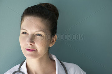 Doctor looking away in thought  portrait