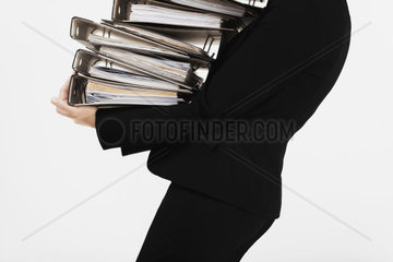 Woman with many folders in the arm  Document  clerk  worker  business woman  red tape  Order  employees  business  office  work  bureaucracy  file  folder  file  date  Suit  Secretary