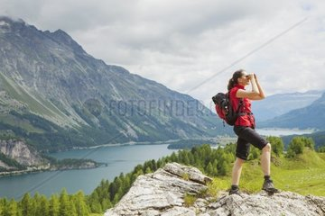 Hiker in the Engadine looking through binoculars  lake  nature  mountains  Switzerland  female  freedom  observing  searching  St. Moritz  rest  sports  energy  Valley  Water  Mountain  Earth  Rock