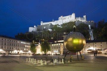 Fortress Hohensalzburg and Kapitelplatz square at night  Salzburg  UNESCO World Heritage Site  Salzburger Land  Austria  Europe