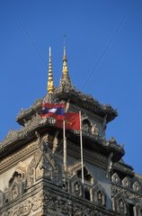 Laos  Vientiane Communist and Laos flags over Patouxai Arch