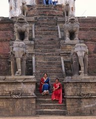Nepal  Bhaktapur  Nepalese young women on temple steps