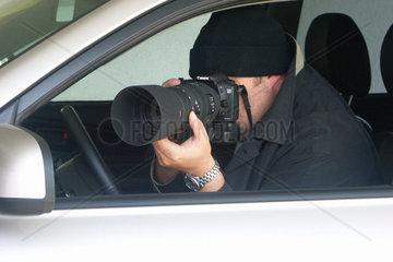 Fotograf im Auto