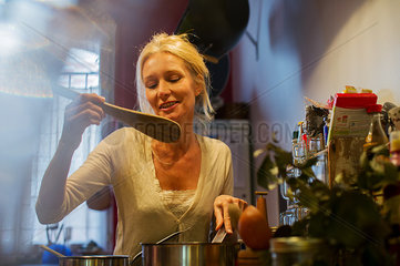 Mature woman cooking at home