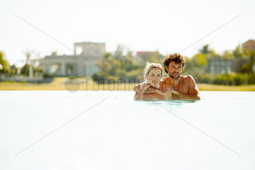 Couple relaxing together in lake