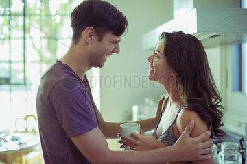 Couple enjoying coversation in kitchen