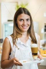 Waitress carrying drink  portrait