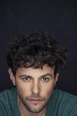Man with one eyebrow raised  portrait