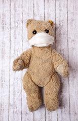 Teddybaer mit Mundschutz