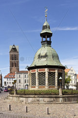 Pavilion fountain on the market place of Wismar  in the background  the St. Mary's Church