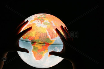 globe and hands