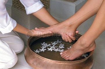 Woman getting a floral foot bath