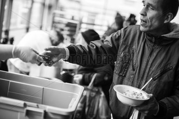 the poor at soup kitchen