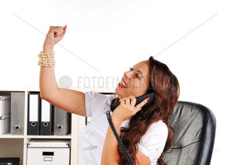 woman to cheer with uplifted arm in the office