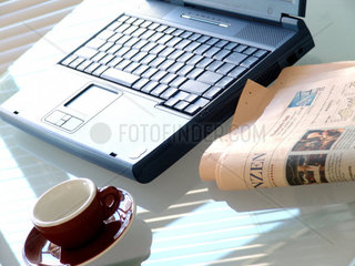 Notebook with newspaper