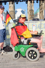 Germany. Berlin - handicapped german football fan at a streetparty