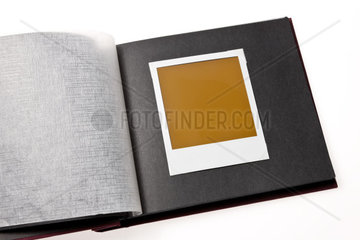 isolated blank photo in a photo album