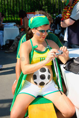 Germany. Berlin - pregnant brasilian football fan at a streetparty