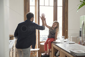 Father and daugther high-five