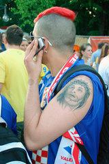 croatian football fan with smartphone