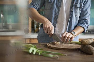 Man cutting spring onion