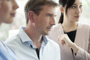 Businessman listening attentively in meeting