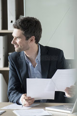 Office worker bored with paperwork