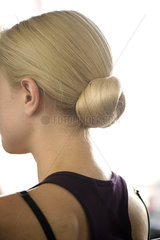 Woman with hair arranged in a chignon
